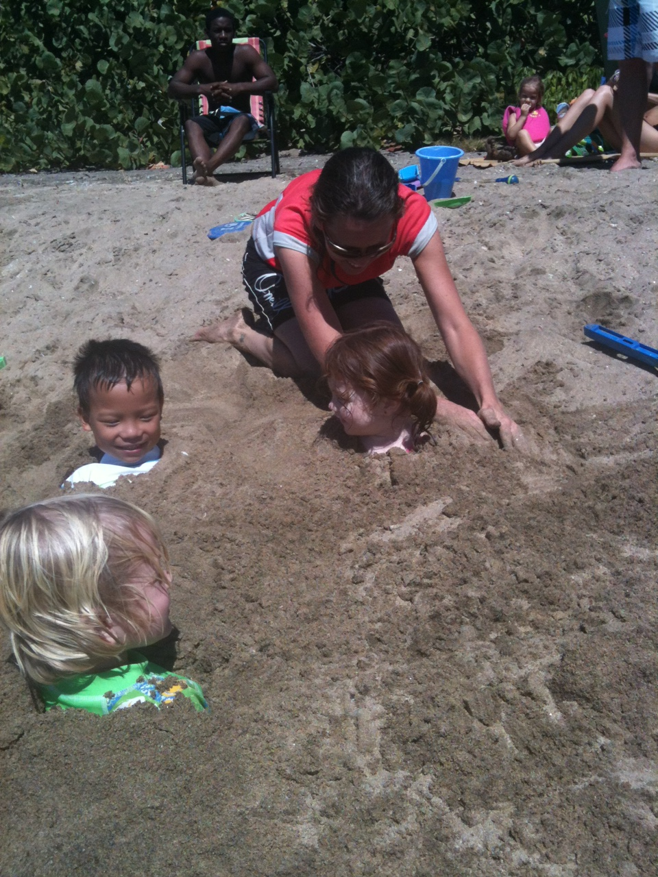 Maddy Getting Buried in the Sand at South Friars Beach in St. Kitts