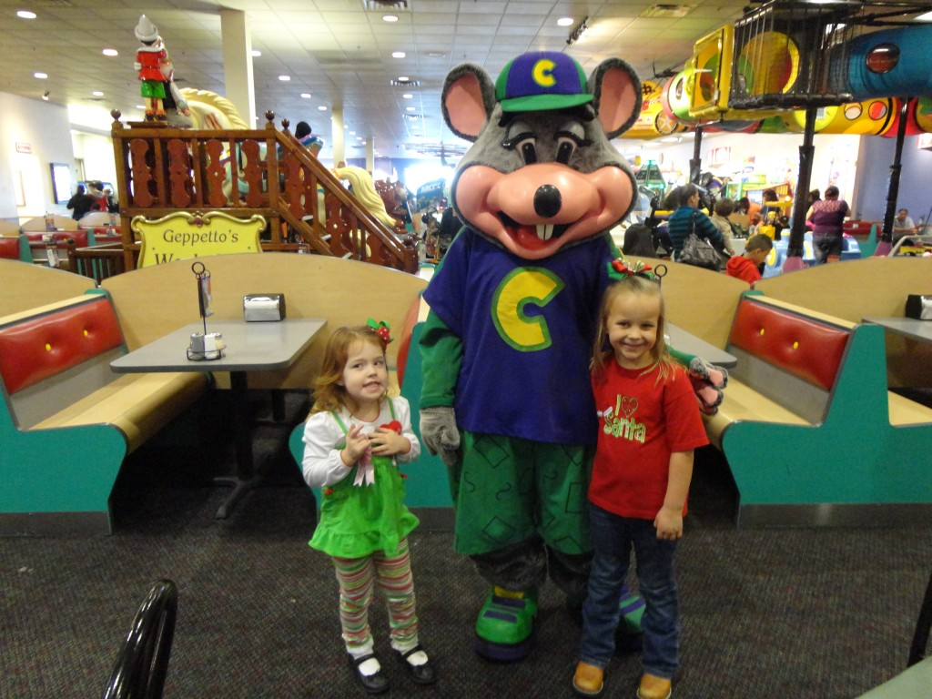 Standing with Chuck E. Cheese